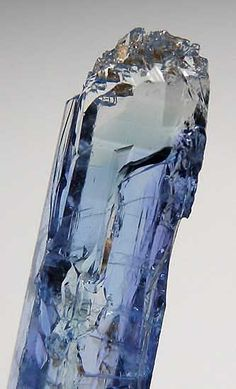 Jeremejevite   Erongo Mountains, Namibia.  Glassy single crystal of relatively large size with excellent blue color throughout most of the crystal with a light blue to clear zone at the very tip. There is natural etching of the termination and some prism faces, though most prism faces are smooth and flat with sharp edges. This crystal was saved from a batch of cutting rough and is wonderfully transparent inside.  From Marin Mineral