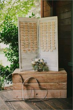 What a unique wedding detail with a rustic touch! Here's a seating plan placecard holder from a repurposed old window shutter where you slip in your guests' placecard between louvers... it is a clever and cute way to show their name along with their table assignment. Photo: The Little Paper Pantry