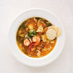 Egg drop soup is usually an appetizer but we made it a main dish by adding shrimp, peas, carrots, and mushrooms.