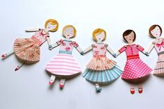 umla:  paper doll garland by rebeccalefeuvre on Flickr.