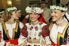 Woman in centre wears costume from village Polomka (Horehronie region, Central Slovakia), other girls wear costumes from village Vrbov (Spiš region, Eastern Slovakia).
