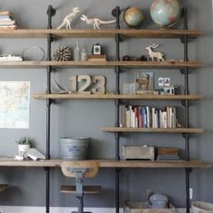 Home office and desk area with homemade wood/pipe shelves. Wood And Pipe Shelves, Wood Shelf, Floating Shelves, Wooden Shelves, Plumbing Pipe Shelves, Wood Wall, Industrial Shelving, Diy Shelving, Industrial Chic