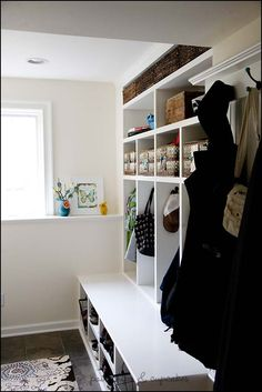 Mudroom... this bench atleast extends out from under the coats, but I am not sure it would be nice for little kids... they would walk on it to get their stuff, so it wouldn't stay clean