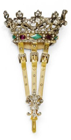 AN ANTIQUE RUBY, EMERALD AND DIAMOND BROOCH FOR PENDANT WATCH, CIRCA 1900. Designed as a crown, set  with one lozenge-shaped and two drop-shaped emeralds, two rubies and 90 diamonds. The lower part with swivel clasps for a pendant watch, with a diamond-set lily motif, mounted in platinum and gold. Length 8 cm. #antique #watch #brooch