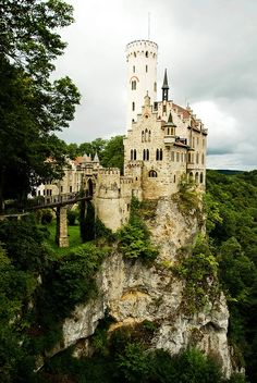 Lichtenstein Castle, Germany ~ Perched on a crag in the foothills of the Alps, The neo-gothic castle was built between 1840-42. The castle's keep and outer buildings are linked by a narrow causeway; its broad crenellated stone walls meld into a cliff face that drops down into the Echaz Valley below.