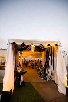 love the idea of a marquee with a little table for the guest book