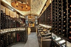 Custom Wine Cellar - Custom wine cellar featuring curved waterfall cabinetry and furniture-grade Mahogany Wagner St., Glenview, Glenview Haus Photo Gallery, Chicago