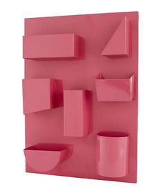 7 Whimsical Kids' Bedroom Ideas: I Could've Bin a Container  The can't-miss colors of these fun wall organizers will help remind them to put away their accessories. And fitting the right-sized objects into the chunky shapes is almost like completing a puzzle.  To buy: 49 each, landofnod.com .