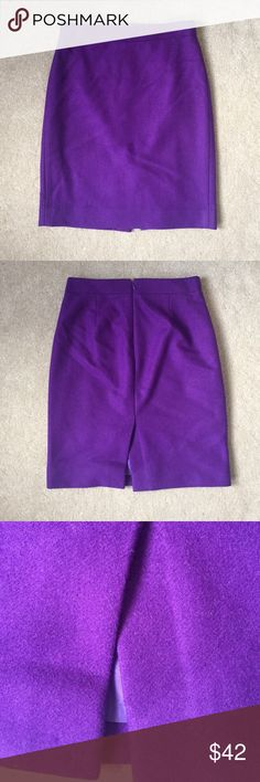 "J. Crew Purple Pencil Skirt 00 ""The Pencil Skirt"" by J. Crew, size 00 in flattering royal purple. Hidden zipper in back with hook-and-eye. Small slit in back so you can walk without being restrained. Fabric is wool with acetate lining. J. Crew Skirts Pencil"