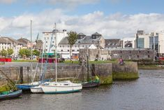 Must Read - Where to stay in Galway - Comprehensive Guide for 2020 - GALWAY, IRELAND – A view from the Claddagh, across the River Corrib, towards The Spanish Steps in Galway, Ireland. Ireland Pubs, Castles In Ireland, Galway Ireland, Ireland Food, Cork Ireland, Backpacking Ireland, Ireland Travel Guide, Maldron Hotel, Ireland Attractions