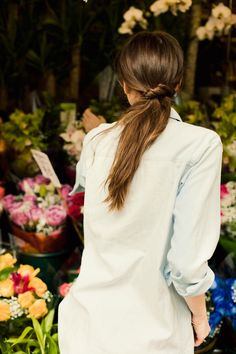 To create this chic low, twisted side pony, separate hair into two sections in the back of your head—leaving most of your hair off to one side, with one much smaller section near your right ear. Secure the larger section into a low pony at the nape of your neck, then take the smaller section and twist the length of it before wrapping it under and around the base of the pony. Once you have only a small amount of hair left, pin it underneath the pony.   - Cosmopolitan.com