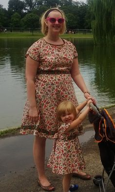 I submitted to one hot, sweaty, exhausted picture just for proof that I made matching dresses. I'm glad I did because the dryer caught my embroidered ties and ripped them and now I have the mend it.