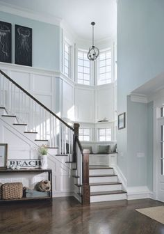 The woodwork on the stairway is amazing. Love how soft the walls look because of its color. Very beautiful home.
