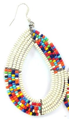 They are definitely distinct and attention-catching. Pick from a variety of various colored or monochromatic styles, mix and match according to your clothes, and existing fashion jewelry. Fulani Earrings, African Earrings, Tribal Earrings, African Jewelry, African Beads, Tassel Earrings, Statement Earrings, Dangle Earrings, Seed Bead Jewelry