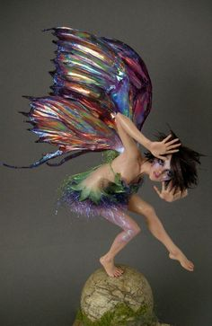 Tinkerbell Surprise 2 by ~wingdthing on deviantART ... rainbow-colored wings on this fairy