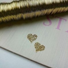 Experimenting with gold glitter embossment & gold wire this morning for a couple of new crafty designs :) #gold #glitter #embossing #handmade #crafty #sundaymorning #experimenting #goldheart #oldnewandbluee #designer #weddingstationery #etsyshop
