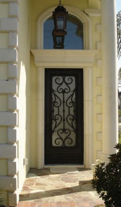 this is exactly what I want for my front door! black door and neat stone work Entrance Doors, Front Doors, Windows And Doors, Gate Design, Door Design, Exterior Design, Cool Doors, Unique Doors, Porches