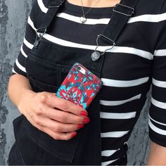 It's so much fun when your all classic black and white outfit gets a little twist with a colorful iPhone case - Shell'Oh! iPhonecase designed by Katariina Karjalainen