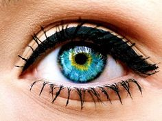 blue eye with yellow ring---winged black thick top lid eyeliner---mascara---eyelashes #eye #pretty