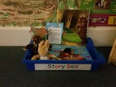 Story box full of the gruffalo. Laminated puppets, soft toys of the characters, gruffalo lotto. The gruffalo book along with a touch and feel gruffalo book.