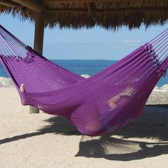A purple Mayan style hammock. These hammocks are unbelievably comfortable. Without the wooden spreader bar, this hammock wraps itself around you and lets you get one of the best naps you'll ever take!