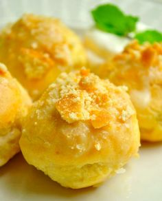 Banana Pudding Cream Puffs: Sweet cream puffs filled with banana pudding and topped with crushed vanilla wafers.