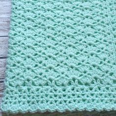 Handmade Mint Green Baby Blanket. Measures 31 × 28 & is made from a soft baby yarn. Machine washable and dryable. Hand crocheted in a pretty shell pattern with a decorative border. Designed and crocheted by me and comes from a non-smoking home. Brand new and ready to ship. Please contact me if you have any questions and check out my store for more handmade items.
