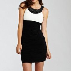 Satiny Dress with Embellished Neck Gorgeous dress with minimal wear - no damage to the dress. Classic black and white piece with beaded detailing around the neck. It is made of polyester and spandex. It is a size 1/2 but fits like a 0. (Model photo thanks to fashionupdate.net) B. Darlin Dresses Midi