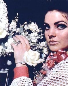 Priscilla Presley. Beautiful & those eyebrows..