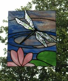 Lovely wings on this dragonfly against a pond and water lily background. Handcraft cottage at Etsy