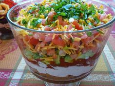 5 Layer Taco Salad Ingredients: 1 ounce) cans spicy refried beans 1 cup sour cream cup mayonnaise 1 ounce) package lawry's taco seasoning mix ( or recipe to taste) 2 ounce) cans diced green chilies ( or salsa) 4 somewhat Mexican Dips, Mexican Food Recipes, Spanish Recipes, Mexican Party, Tostadas, Mayonnaise, Nachos Supreme, Trifle Dish, Cooking Recipes