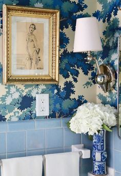 Blue and white powder room designed by Shaun Smith featuring the Alton Pivoting Sconce by Thomas O'Brien #circalighting