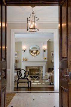 Traditional corridor leading into a glamolous living room designed by CMID…
