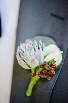 We love a unique boutonniere: http://www.stylemepretty.com/california-weddings/san-clemente/2013/07/25/san-clemente-wedding-from-carly-daniel-photography/ | Photography: Carly Daniel - http://carlydaniel.com/