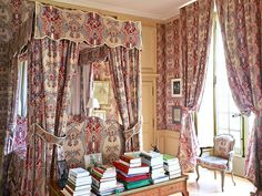 An elaborate Braquenié printed cotton known as La Valette decorates a bedroom at Château de Montgeoffroy, an 18th-century French manor house that is home to the Marquis and Marquise de Contades.