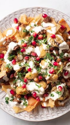 Melt-in-your mouth creamy eggplants, savoury bits of beef and tasty fried chickpeas on a bed of crispy pita chips! THEN slather with a yummy garlic-y yogurt sauce! If you're not a fatteh lover yet, this Beef & Eggplant Fatteh is sure to make you a raving fan!