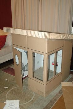 I ran across this playhouse , which is incredible, but beyond my budget. When we bought a gas grill, the giant empty box was the perfect op...