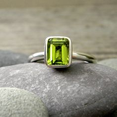 I love green! Peridot and Sterling Solitaire Ring Emerald Cut by onegarnetgirl via Etsy, $163.00