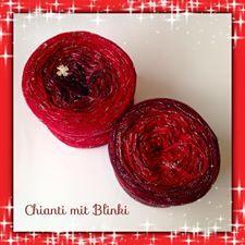 rot, kirsche, bordeaux und ein feiner Faden Lurex in schwarz/silber