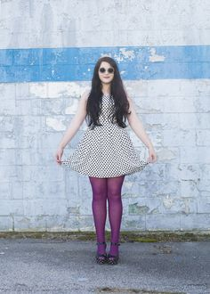 Purple tights make for a fun pop of color in a black and white ensemble!