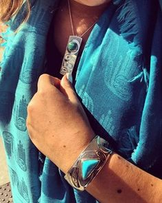 Who else is feeling this autumn chill today? It's the perfect time to wrap up in one of Dorothy Grant's beautiful shawls - we love it accented with turquoise jewelry.