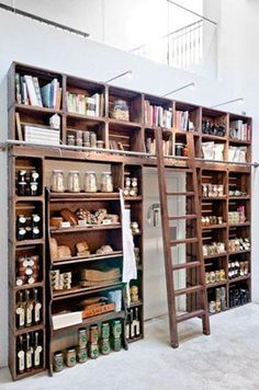 Nice shelving wall around doorway lots of storage in a small footprint BOISERIE & C.