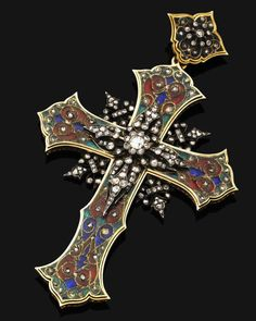 An antique gold, enamel and diamond cross, circa 1880  Of Byzantine style, the polychrome cloisonné enamel cross inset with rose-cut diamonds, the central silver plaque mounted with old brilliant-cut and rose-cut diamonds, to the similarly-set surmount, possibly Italian, mounted in silver and gold, gross weight 33.3 grams, length 9.5cm