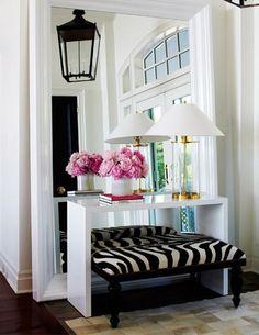 Zebra bench entryway with giant mirror