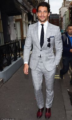 Check mate: Model David Gandy smouldered in a pale grey check suit...