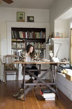 Jessica Niello uses the living room as her art studio. She found the drafting table at a garage sale in the Mission District. Photo: Kelly Ishikawa, Styling By Rod Hipskind