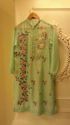 I love the embroidery and the color