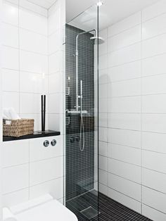 Gorgeously simple... White Gloss 200X600 White Wall Tile with Black Gloss Rectangle Mosaic for shower feature wall & floor... I love the repetion of shape...