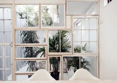 Great idea to use reclaimed window frames to make a room divider.