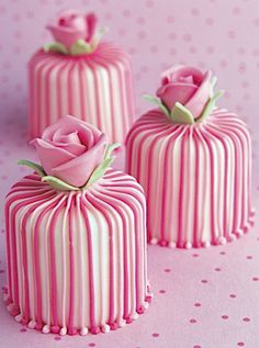 Pink And White Striped Mini-Cakes With Rose On Top.